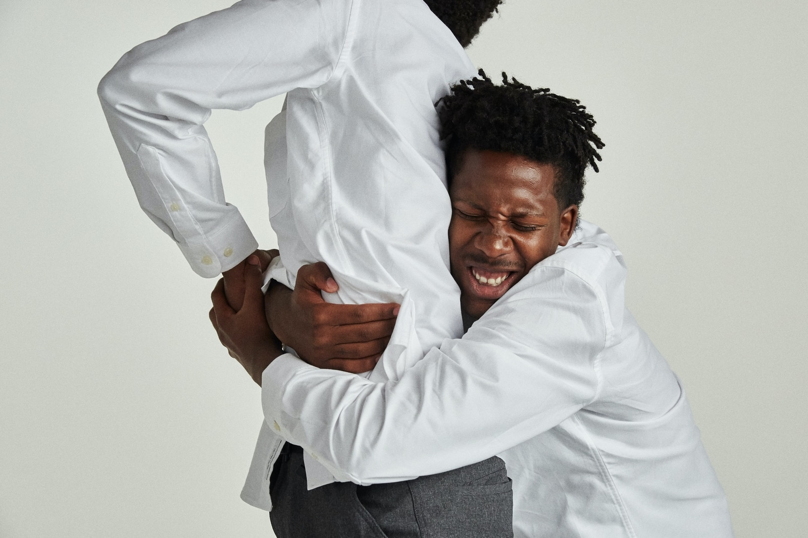 Friendship: Man hugging another man