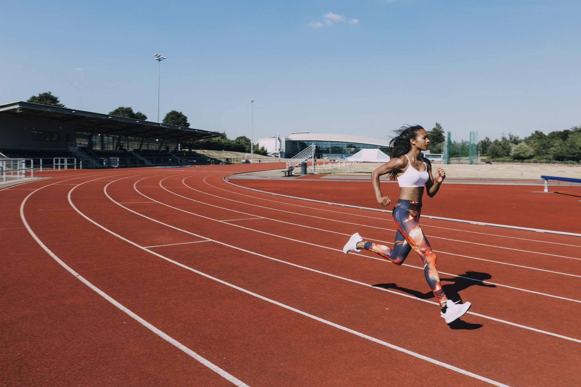 Woman running confidently on a track