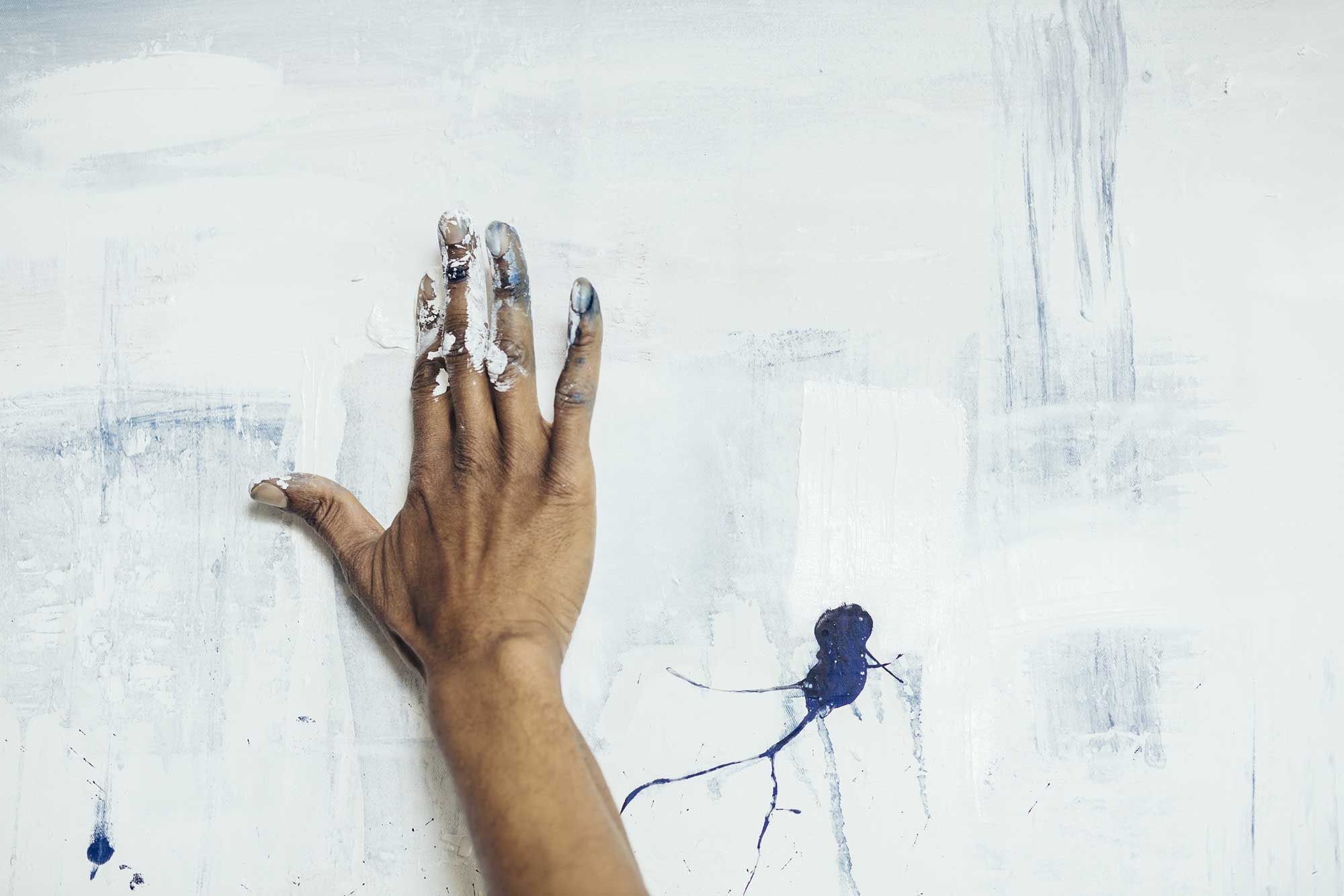 Artist painting on a white canvas